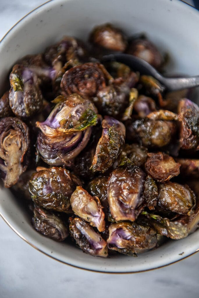 close up view of grilled purple Brussels sprouts