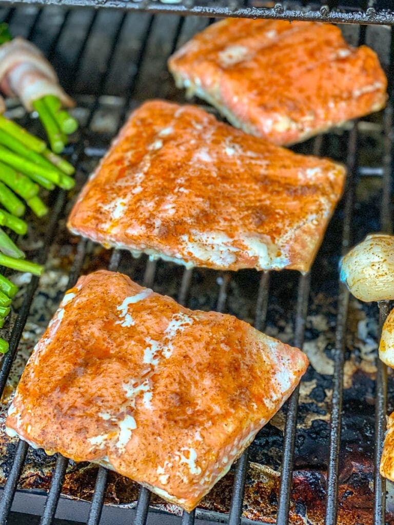 3 pieces of salmon lined up front to back on grill
