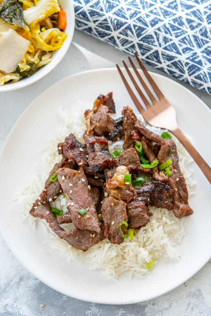 beef bulgogi on white plate with fork