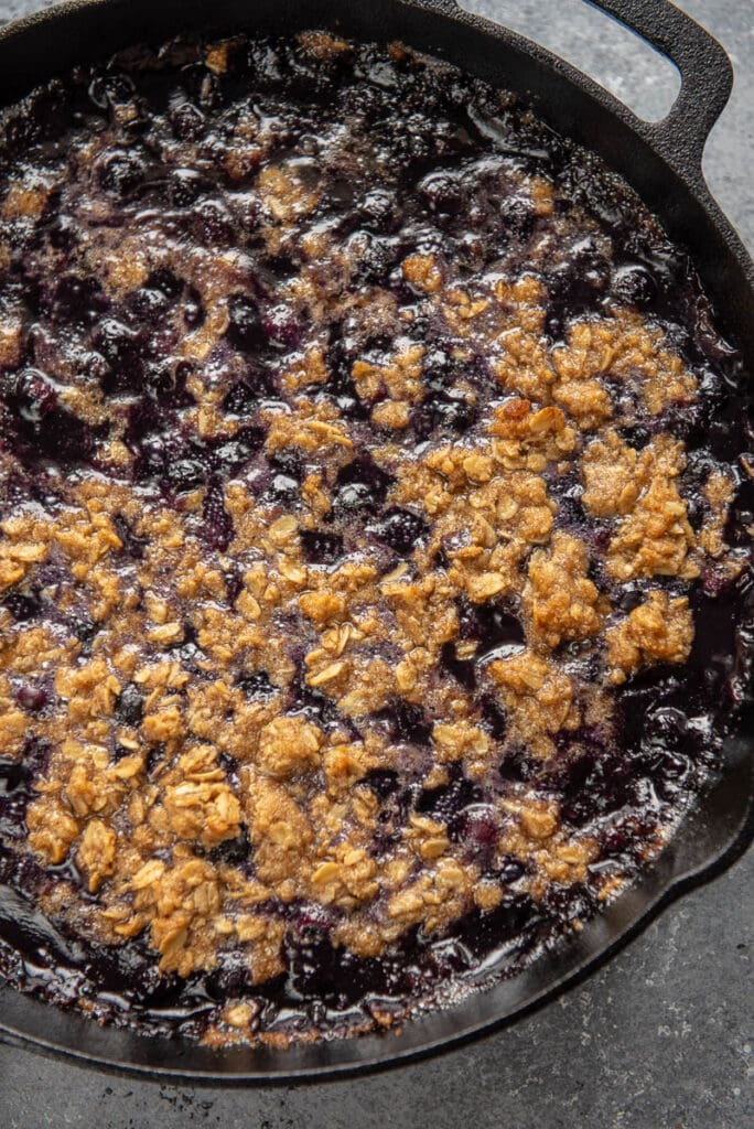 blueberry crumble in a cast iron skillet
