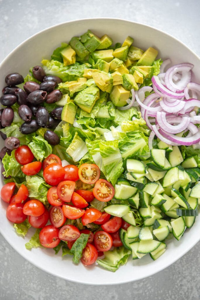salad fixings in white bowl