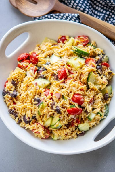 greek orzo salad in a white bowl