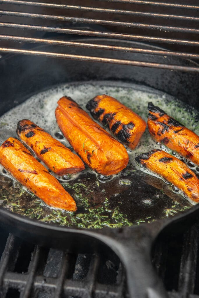 carrots and seasonings grilling on a grill pan