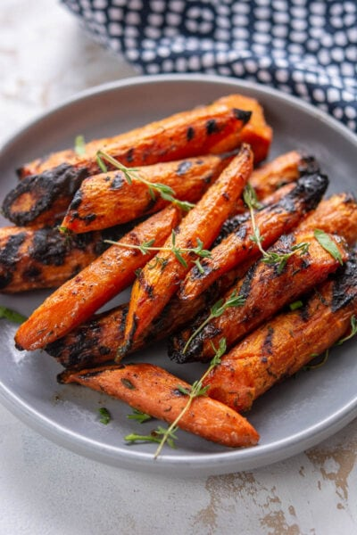 grilled carrots on a gray plate