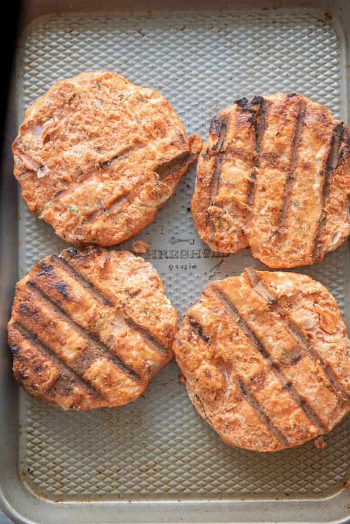 grilled salmon burgers in a pan