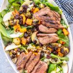 fall steak salad on a white plate