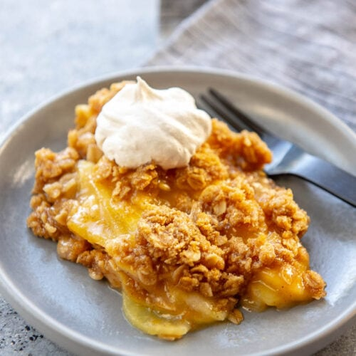 apple crumble on a plate with a fork