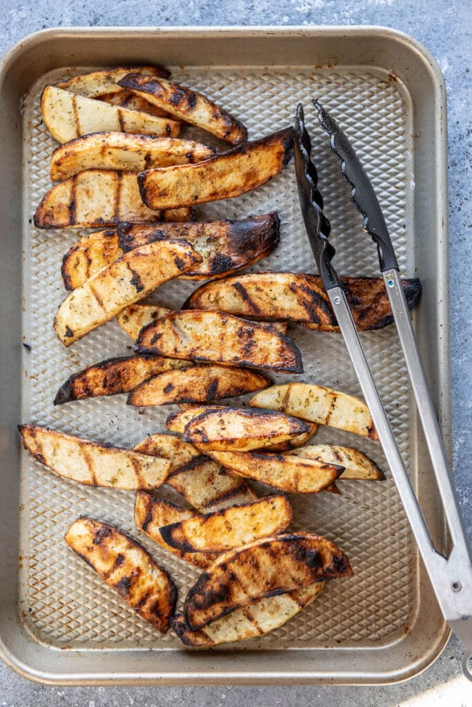 grilled potato wedges on a grill pan