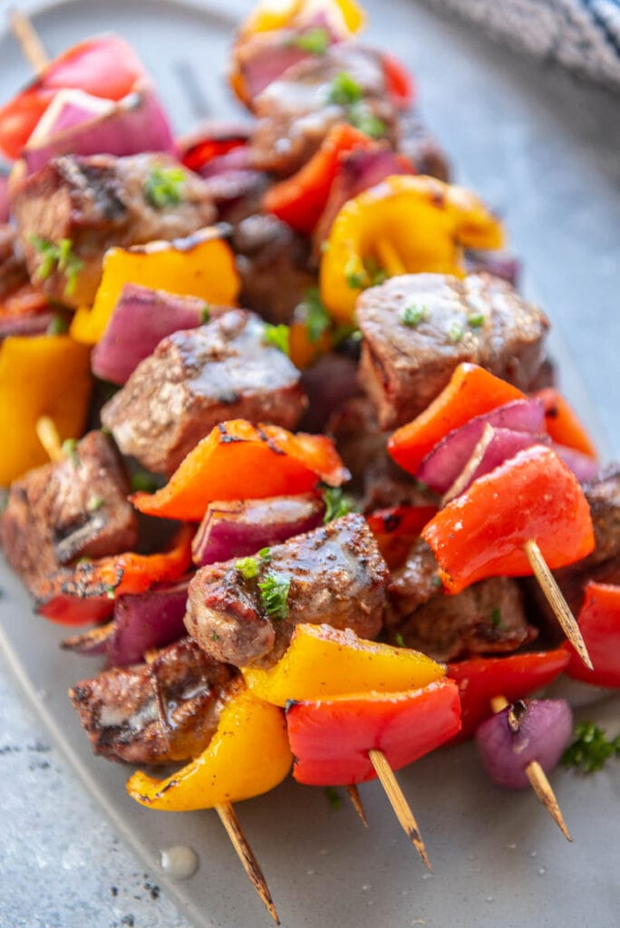 steak kebabs on a platter