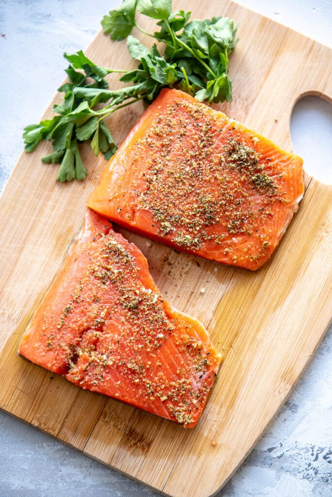 salmon fillets on a wood plank